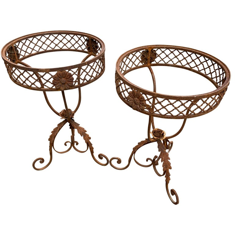 Pair of Frenchround wrought iron and marble garden bistro tables.