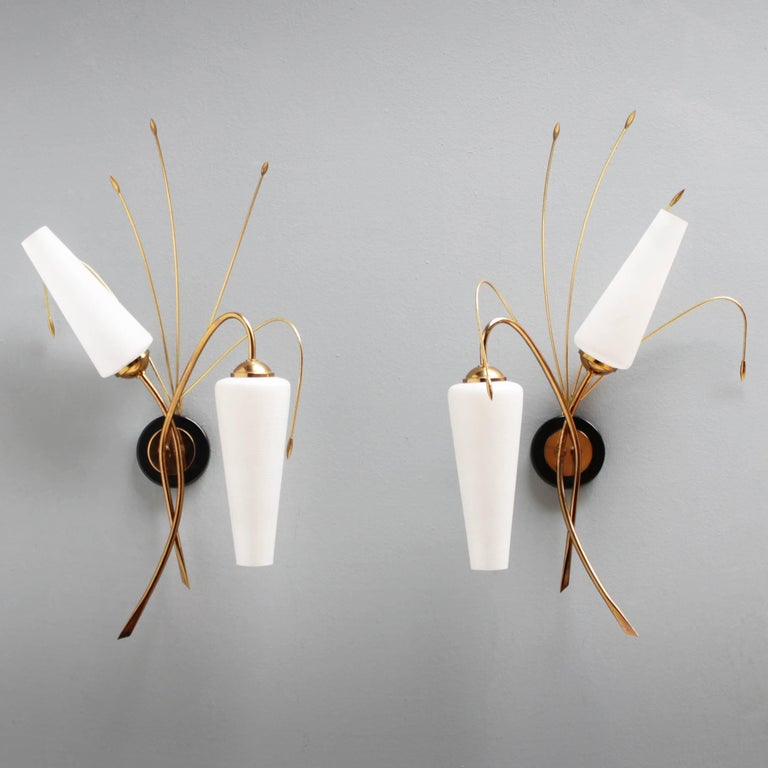 Pair of elegant French sconces attributed by Maison Arlus. Each sconce has two bayonet bulbs (BA15d, IEC 7004-11 A, DIN 49720). With beautiful brass details. Dimensions: Height 22.8 in. (58 cm), depth 5.9 in. (15 cm) and width 13.8 inches (35 cm).