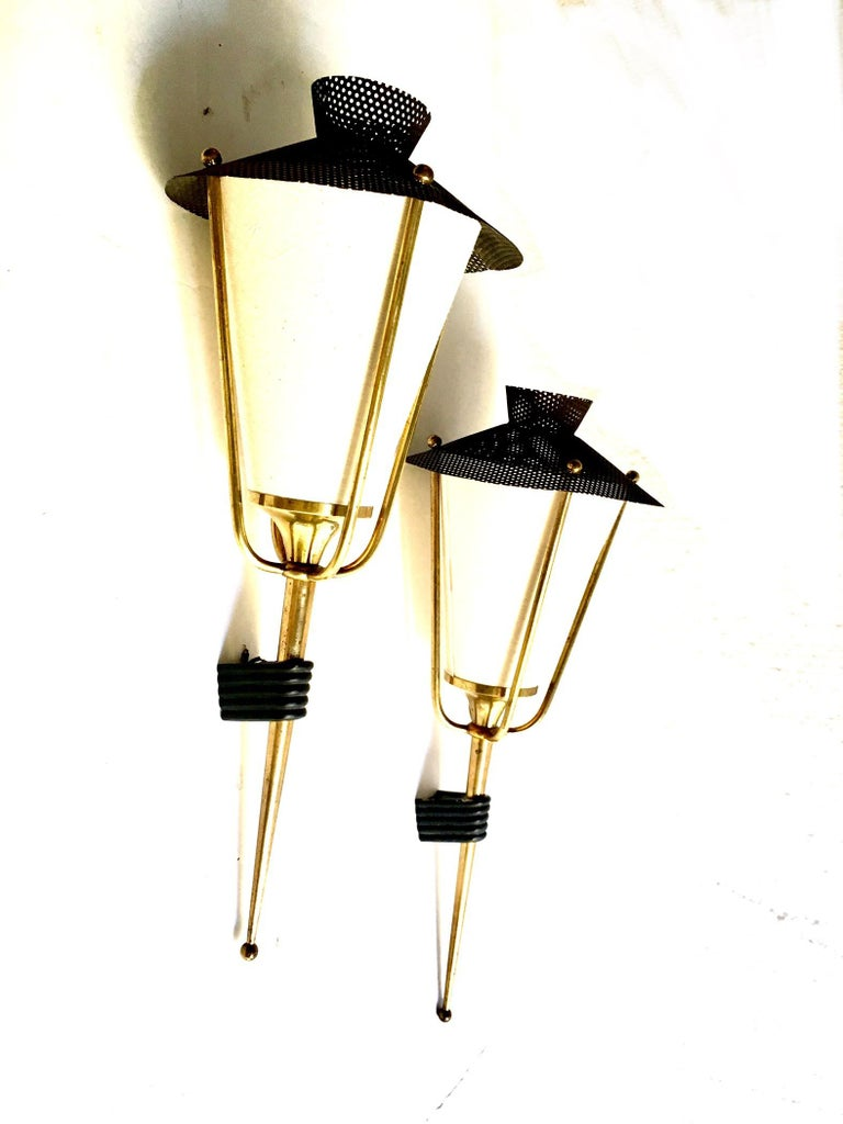 Pair of perforated metal lantern wall sconces in black in the style of Mathieu Mategot manufactured by Maison Arlus, the shades are not the original ones, they are currently manufactured. We have two pairs.