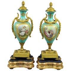 Pair of French Sevres Hand Painted & Gilt Porcelain & Bronze Pictorial Urns