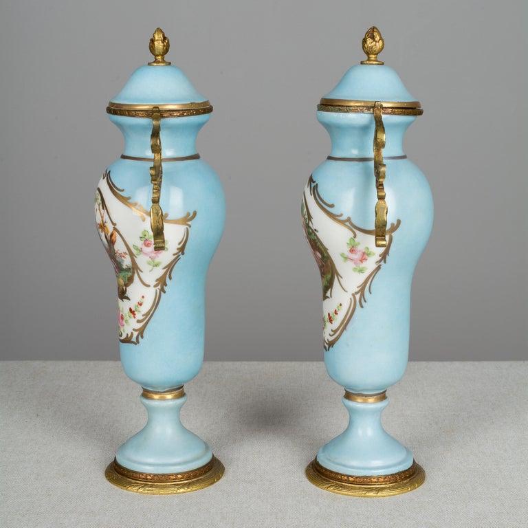 Cast Pair of French Sèvres Porcelain Urns For Sale