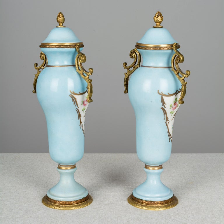 Bronze Pair of French Sèvres Porcelain Urns For Sale