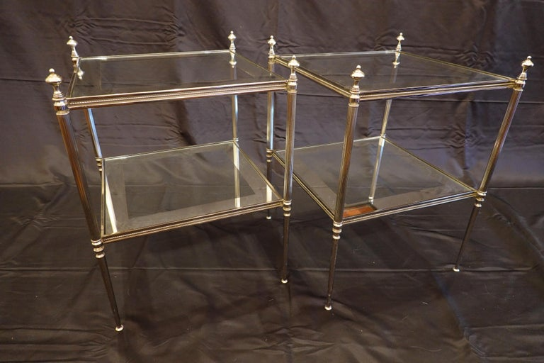 20th Century Pair of French Silvered-Bronze Two-Tiered Side Tables with Glass Tops For Sale