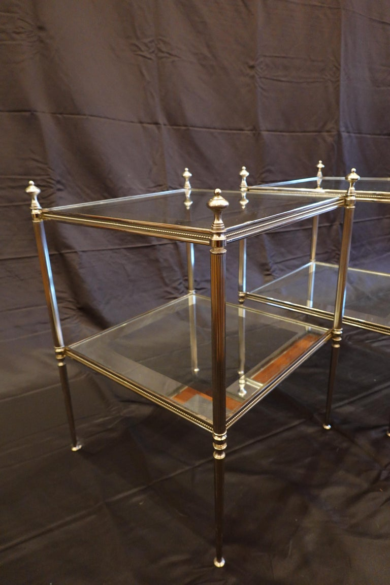 Brass Pair of French Silvered-Bronze Two-Tiered Side Tables with Glass Tops For Sale
