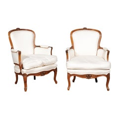 Pair of French Stamped Louis XV Style 19th Century Upholstered Walnut Armchairs