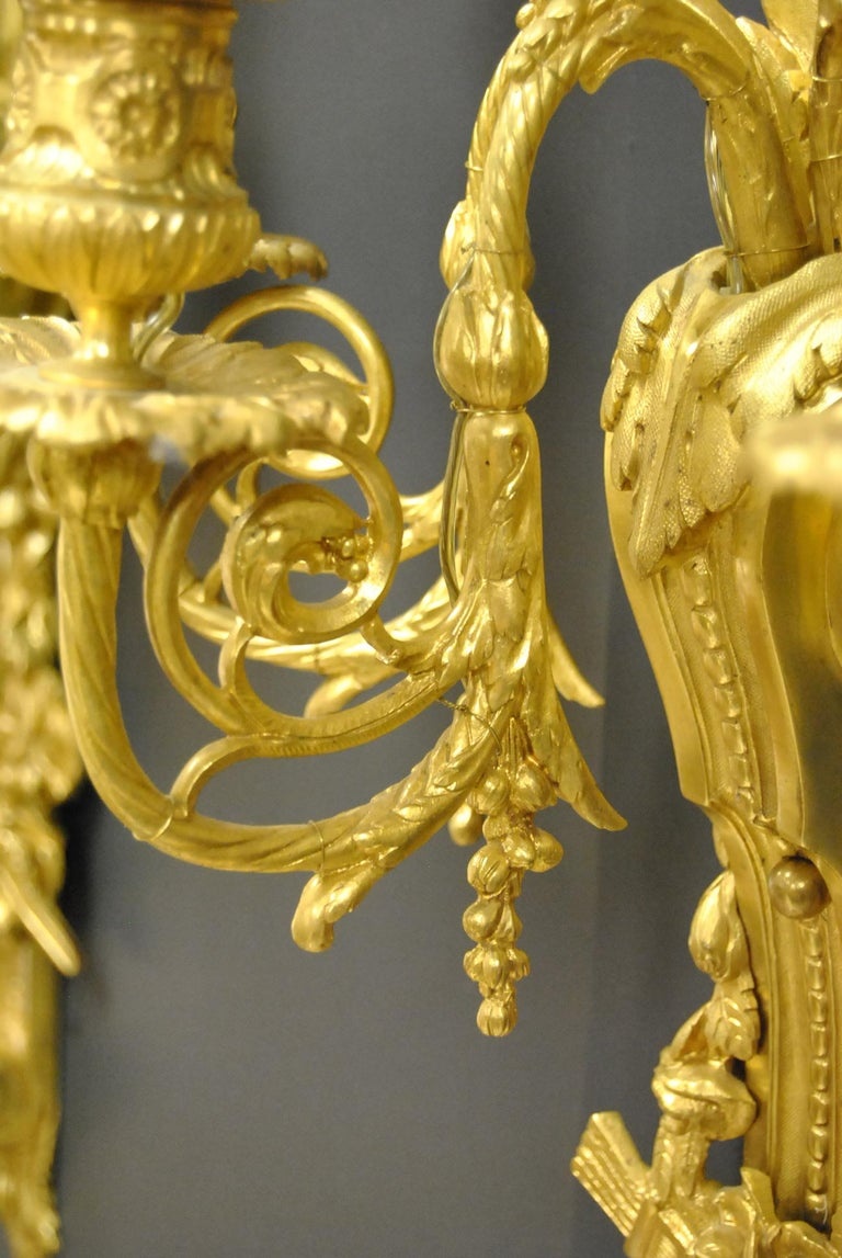 20th Century Pair of French Style Bronze Three-Arm Gold Dore Sconces Fruit and Floral Details For Sale