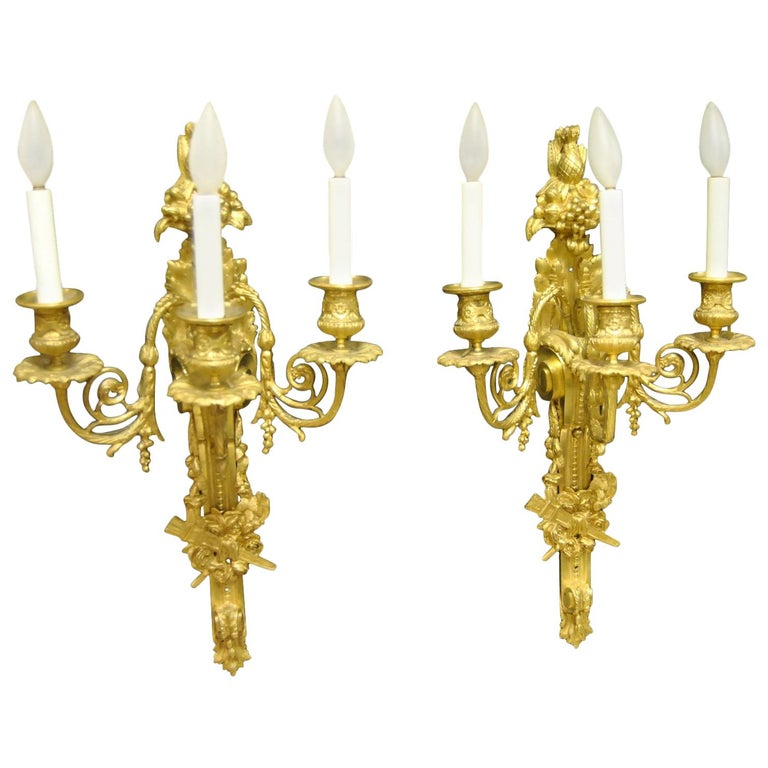 Pair of French Style Bronze Three-Arm Gold Dore Sconces Fruit and Floral Details For Sale