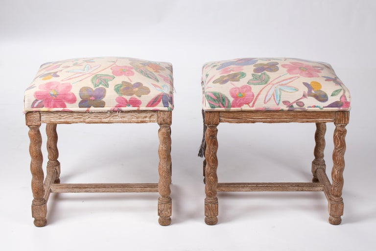Pair of French style carved wooden upholstered stools in vintage flower pattern.