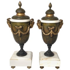 Pair of French Style Marble and Patinated Metal Garniture Urns with Rams Heads
