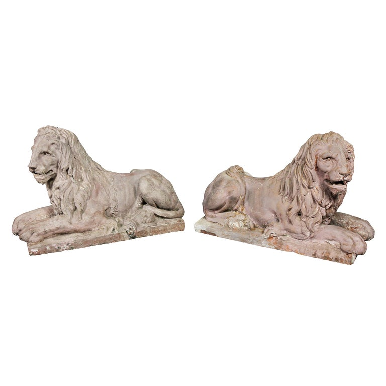 Pair of French Terracotta Figures of Crouching Lions For Sale