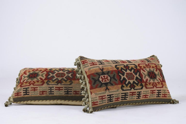 This beautiful pair of French 19th century accent decorative pillows are made out of antique floral pattern tapestry and have a gold color velvet fabric on the sides and back. They are also beautifully finished with decorative multicolored tassels,