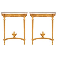 Pair of French Turn of the Century Louis XVI St. Giltwood and Marble Consoles