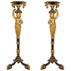Pair of French Victorian Gilt and Black Trimmed Cupid Pedestals