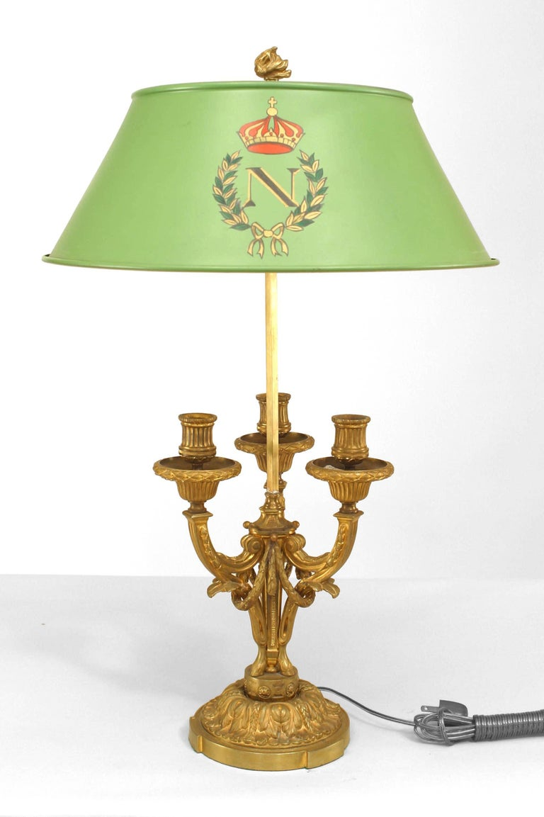 Pair of French Victorian, 19th-20th century gilt bronze three-arm bouillotte lamps with foliate/swag details mounted on a round base with a round modern decorated tole shade with a flame finial.