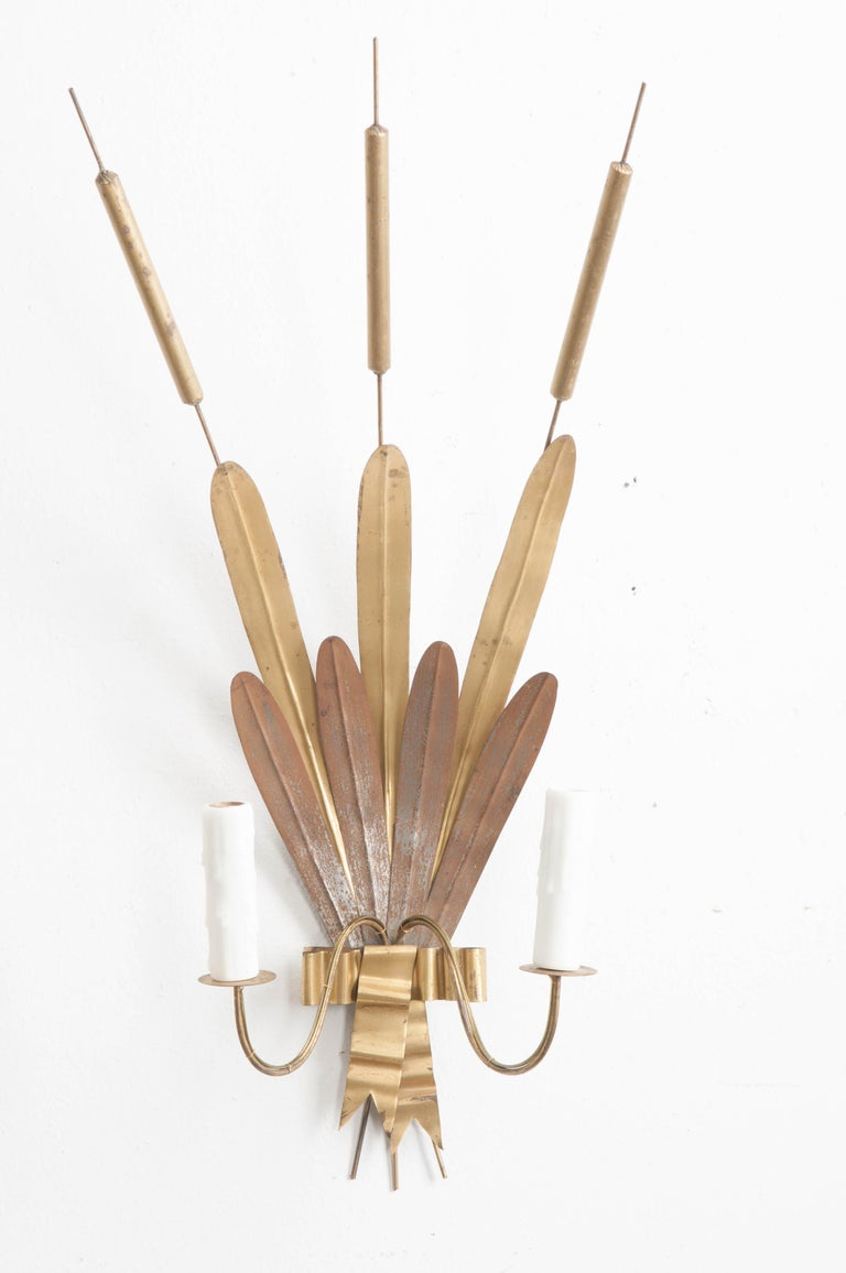"""This stylish and large pair of vintage gilt-metal """"cattail"""" sconces, from France, are virtually as weightless as cast light! The gilt-metal will provide extra illumination and ambiance with the light they reflect. UL approved wiring for the US."""