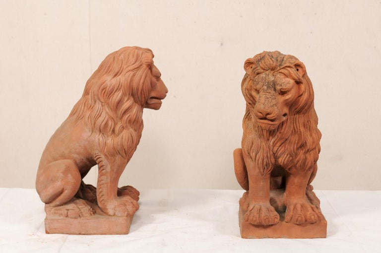 Carved Pair of French Vintage Terracotta Snarling Lion Statues For Sale