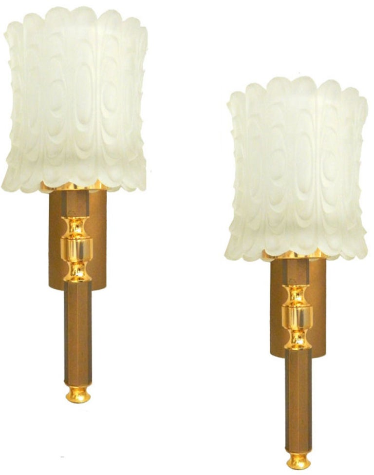 Pair of circa 1950s wall sconces. Maximum wattage: 60w Original thick frozen glass shades. Have a look on our impressive collection of French and Italian Sconces......More than 200 pairs...