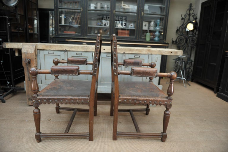 Pair of French structure in solid walnut wood armchairs, seat and back in original nailed brown leather circa 1900 weight 7 kg each price for the pair.