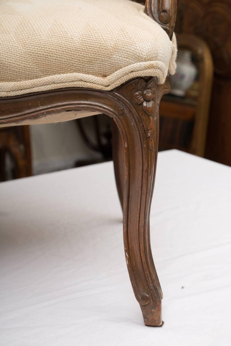 Hand-Carved Pair of French Walnut Fauteuil Upholstered Chairs For Sale