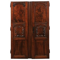 Pair of French Walnut Hand Carved Wooden Doors with Foliage Motifs, circa 1750