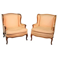 Pair of French Walnut Louis XV Bergere Fireside Lounge Chairs, circa 1950s