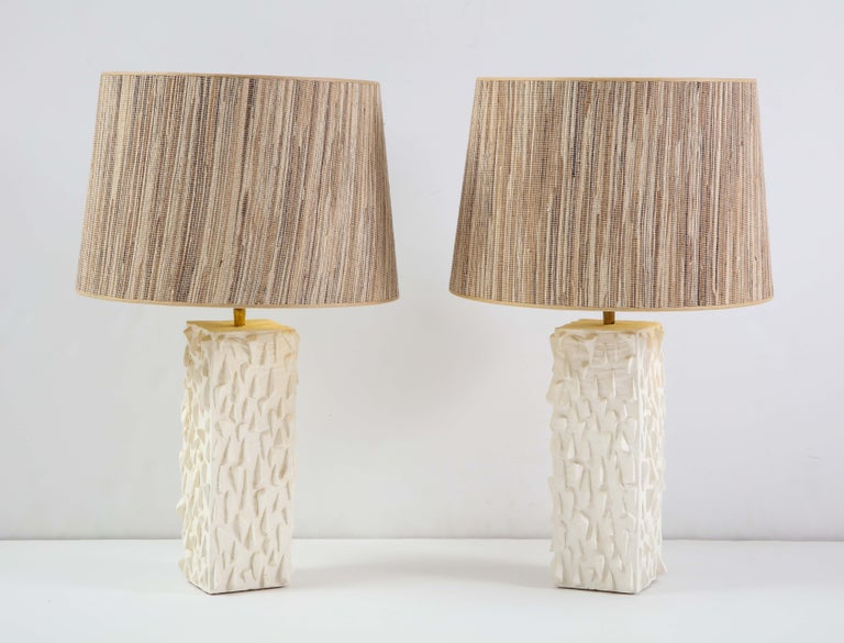 Pair of French white ceramic lamps, signed Vincent V.