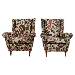Pair of French Wingback Chairs upholstered in Floral Fabric