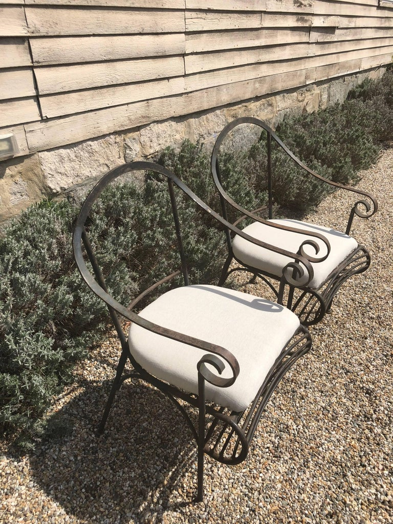 These wrought iron chairs from the 1960s are perfect indoors or out flanking a coffee or bistro table. With a sleek, curved form and slip seat cushions, they are easily recovered and you may even want to add a back cushion as well. They have a nice