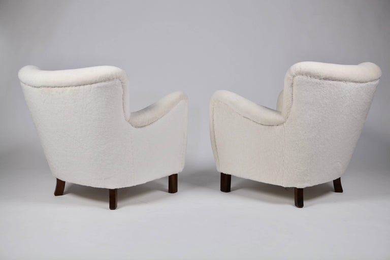 A pair of sculptural easy chairs.  Designed 1938 and made by Fritz Hansen in the 1940s.  Legs of stained beech, new upholstery in Angora Mohair.  Excellent condition.