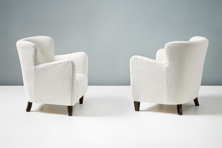 Fritz Hansen  Armchair, circa 1940s  Pair of armchairs by Fritz Hansen, produced in Denmark in the 1940s. The chars have tapered, stained beech front legs and have been reupholstered at our London workshops in off-white, cotton-wool blend boucle