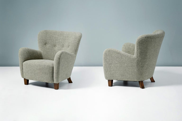 Fritz Hansen  Model 1669 Variant Armchairs, c1950s  Pair of armchairs produced by Fritz Hansen in Denmark in the 1950s. This model is a variant of the Model 1669 chair with a more curved back and tapered stained beech legs. The chairs have been