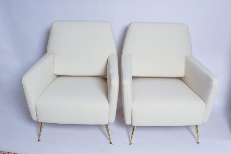 A super-chic pair of 1950s Italian Modernist lounge chairs, fully restored, with all new foam, polished brass legs, and Beacon Hill super-fine wool bouclé upholstery. We've lusted after these chairs ever since we spied them in a Parisian apartment