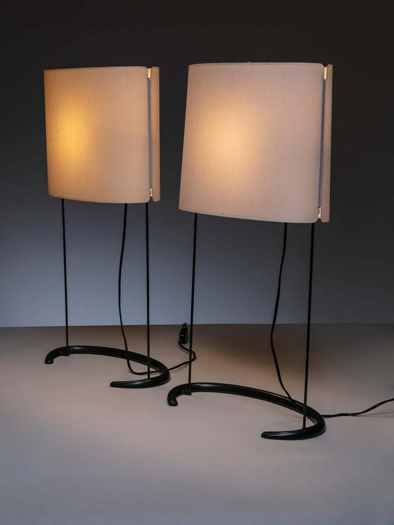 Gala table lamps by Paolo Rizzatto for Arteluce. Sleek curved metal base and lampshade in synthetic fiber.