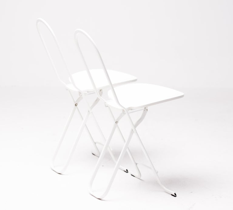 These sleek but sturdy Dafne folding chairs were designed by Gastone Rinaldi for Thema Italy in 1979. 