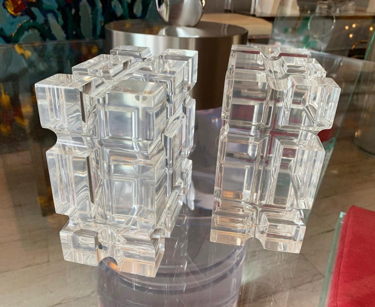 Stunning and beautiful pair of geometric bookends in polished Lucite designed by Amparo Calderon Tapia for Cain modern, the pieces have wonderful shapes and look beautiful against the light, they can be used as bookends or just