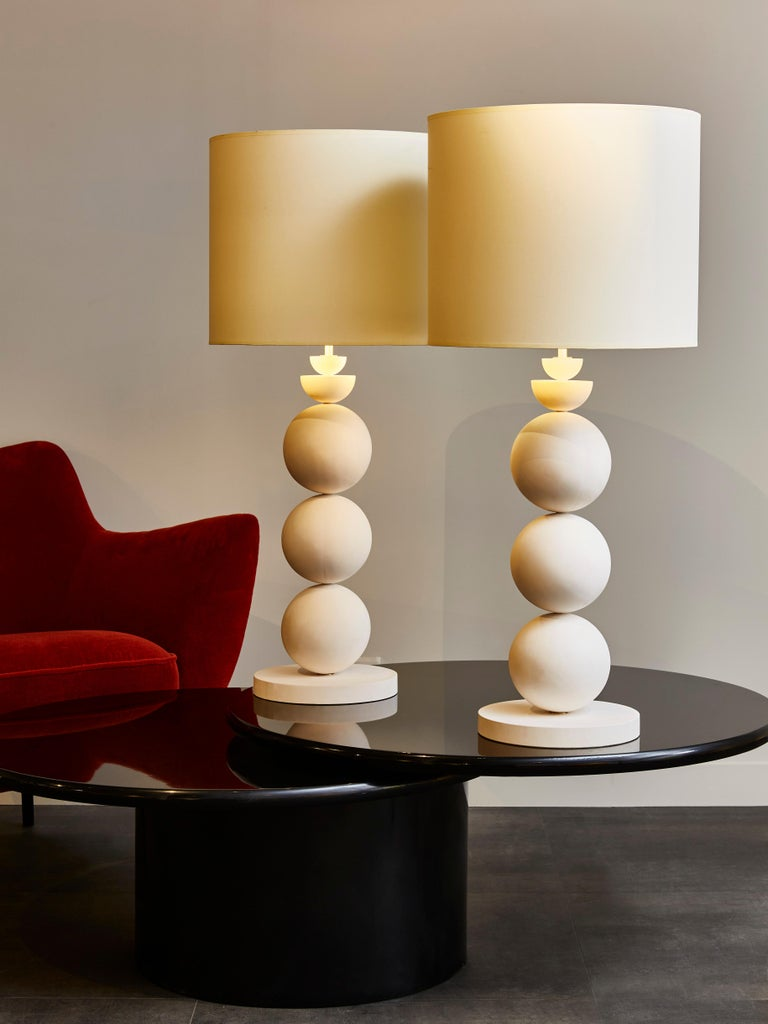 Pair of elegant table lamps made of stacked plaster globes.