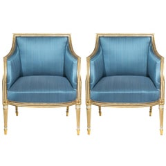 Pair of George III Louis XVI Style Cream Painted and Gilt Bergère Armchairs