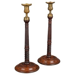 Pair of George III Mahogany and Brass Candlesticks