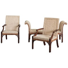 Pair of George III Mahogany Gainsborough Armchairs and Accompanying Stool