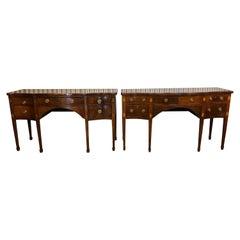 Pair of George III Mahogany Serpentine Sideboards