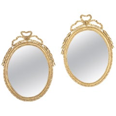 Pair of George III Oval Giltwood Mirrors