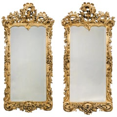 Pair of George III Style Carved Giltwood Mirrors