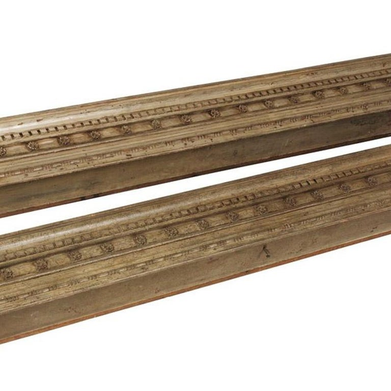 Pair of George IV carved and painted pine pelmets.