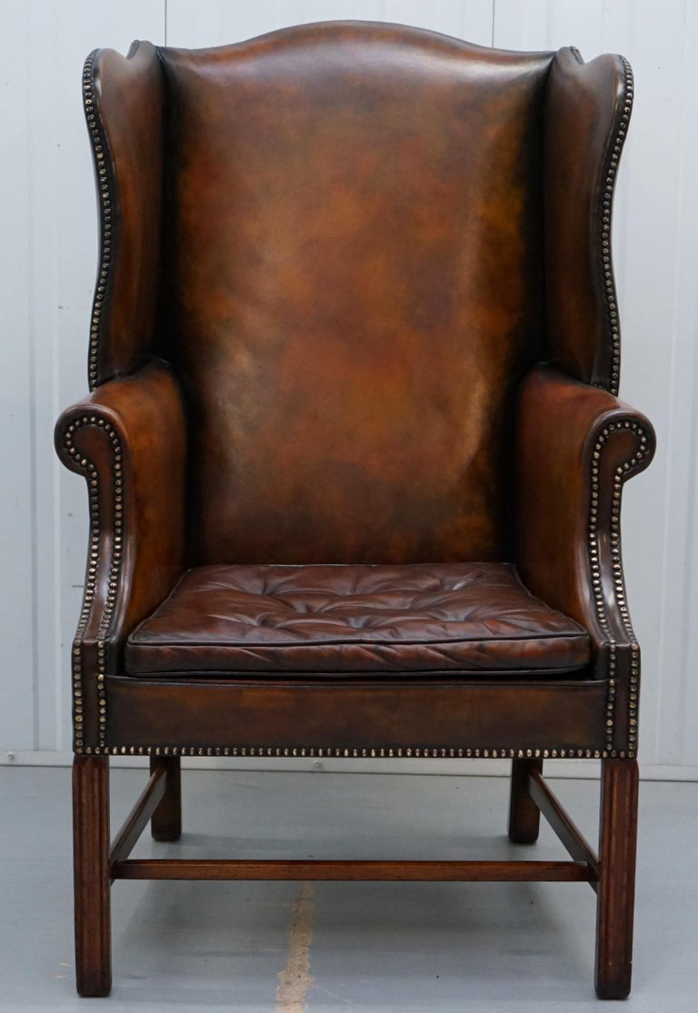 English Pair of Georgian, circa 1820 Restored Hand Dyed Brown Leather Wingback Armchairs For Sale
