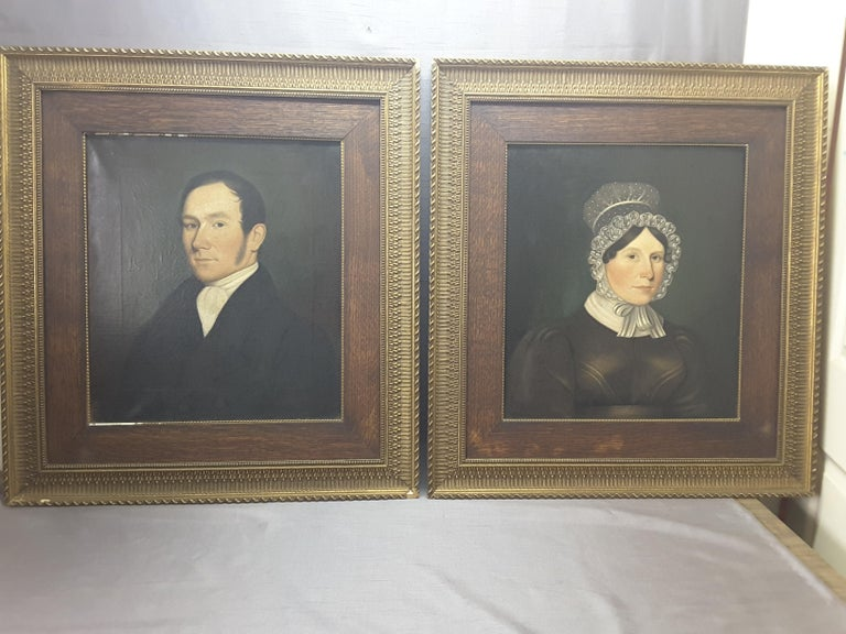 A pair of Georgian English 19th century portraits of a gentleman and a woman, oil on canvas, original frame and stretcher, crackle paint (stable condition) typical of older paintings of this vintage. The paintings are marked on verso, Painted by