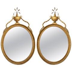 Pair of Georgian Oval Giltwood Mirrors
