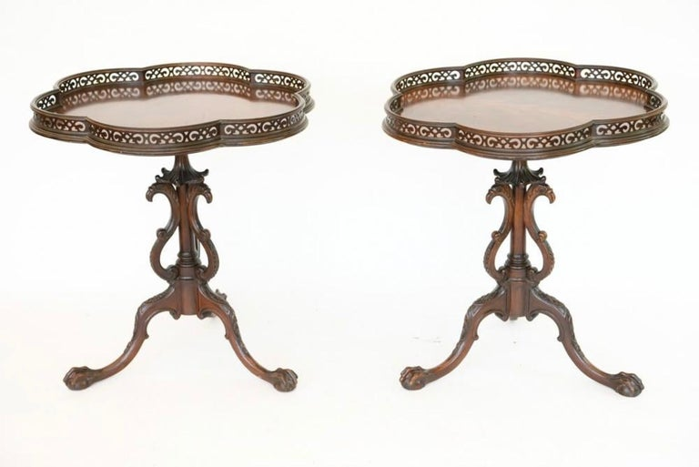 Elegant and stylish, these scalloped or pie shaped gallery top occasional end tables with wonderfully elaborately carved center support are made by Grand Rapids Furniture Company with label underneath. In 1902, furniture companies in Grand Rapids