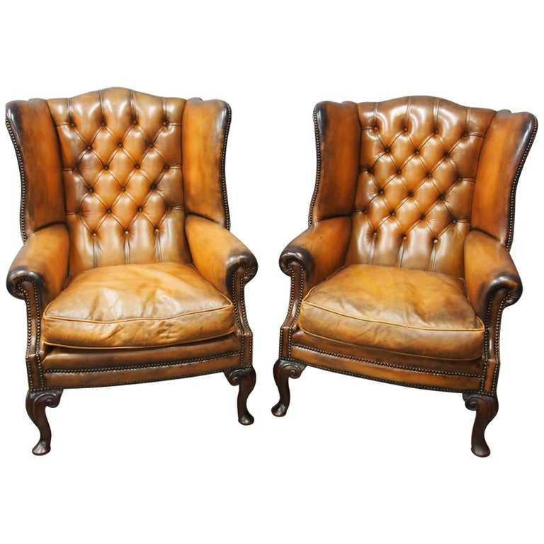 Pair Of Georgian Style Tan Leather Wing Chairs For