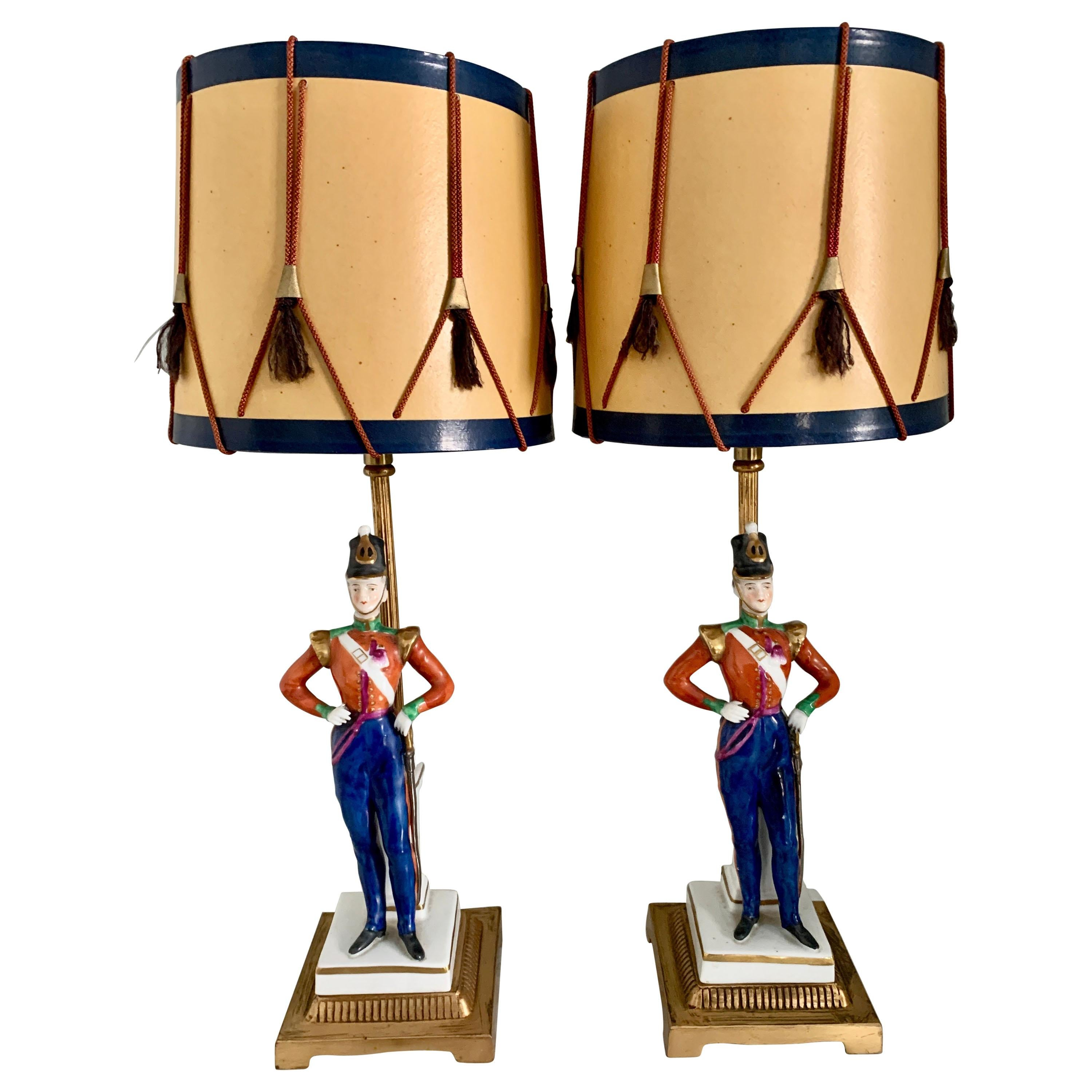 Pair of German Porcelain Soldier Lamps on Bronze Mounts with Drummer Shades