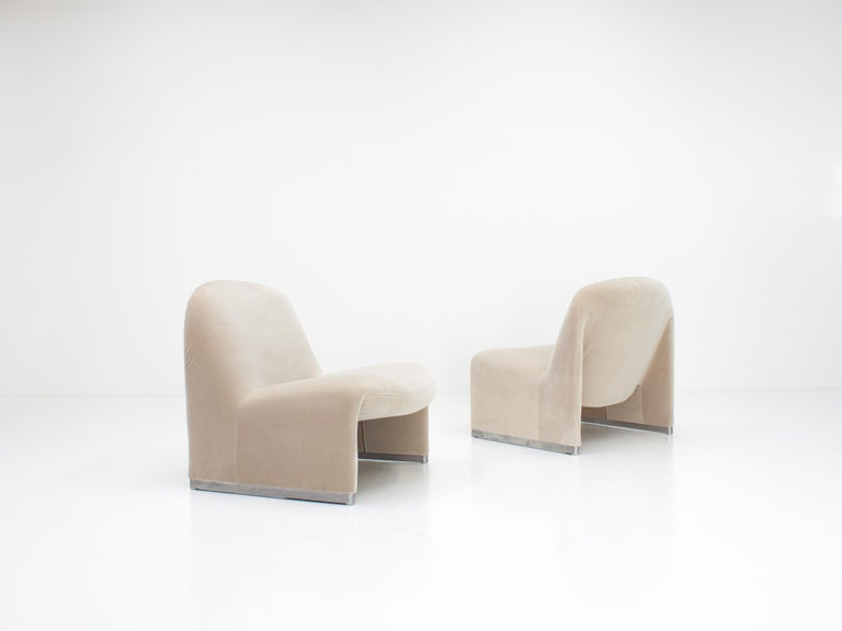 """A pair of Giancarlo Piretti """"Alky"""" chairs newly upholstered in designers guild linen colored velvet. Manufactured by Artifort in the 1970s.  The organic shape offers a minimal appearance but also comfort."""